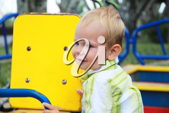 Royalty Free Photo of a Little Boy Playing at a Park