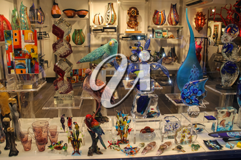 Venice, Italy - August 13, 2016: Traditional Venetian souvenirs in gift gallery in historic city centre