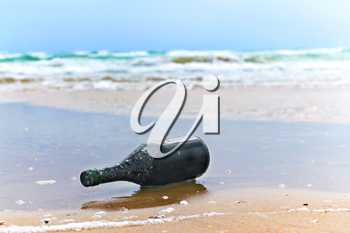Royalty Free Photo of a Bottle on the Beach