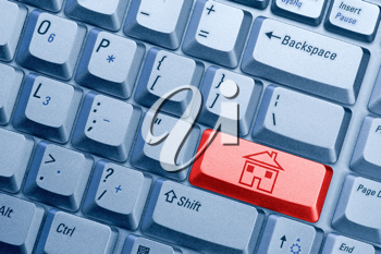 Royalty Free Photo of a Keyboard With a House Icon
