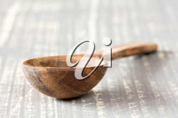 Wooden spoon on the grey wooden table