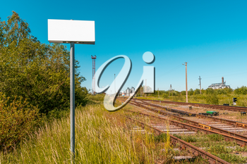 Blank banner in front of empty railroad