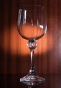 Empty glass on the brown wooden  background