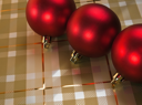 Three red holiday decorative ball