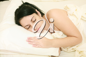 Portrait of beautiful young woman sleeping on the bed.