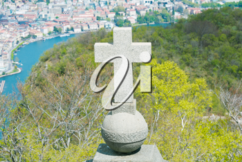 View of Lugano from San Salvatore mountain with a cross in front