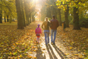 Royalty Free Photo of a Family Walking Through a Park