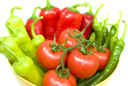 Royalty Free Photo of a Bowl of Peppers and Tomatoes