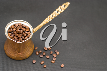 Royalty Free Photo of a Cup of Coffee Beans