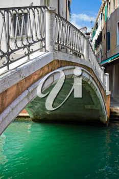 Royalty Free Photo of a Bridge Over a Canal in Venice
