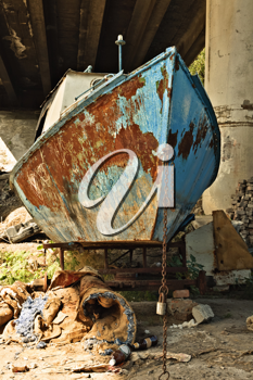 The old rusty boat under the bridge