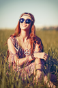 Portrait of a beautiful young hippie girl in the field