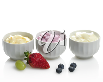 Royalty Free Photo of Fresh Assorted Yogurts with Fruits and Berries