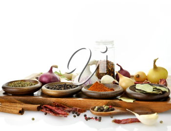 Royalty Free Photo of an Assortment of Spices on a Cutting Board