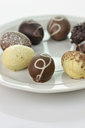 assortment of chocolate eggs on a plate