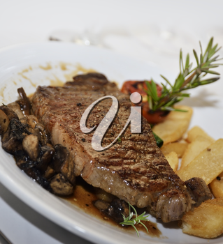 Grilled Steak With Mushrooms And Potatoes