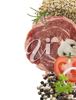 Red Raw Meat Steak With Spices And Vegetables Isolated On White Background