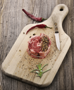 Piece Of Red Raw Meat Steak  On The Cutting Board