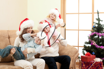 Royalty Free Photo of a Family Wearing Santa Claus Hats