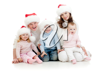 Royalty Free Photo of a Family Wearing Santa Hats