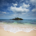 Royalty Free Photo of a Small Island in the Ocean