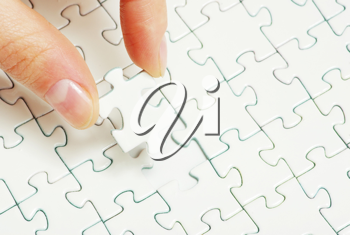 Royalty Free Photo of a Person Holding a Puzzle Piece
