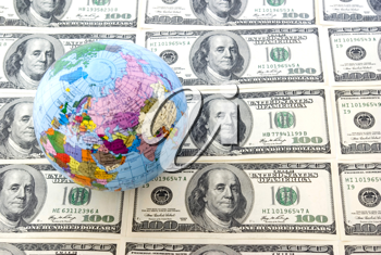 A globe and dollars is isolated on a whiteness