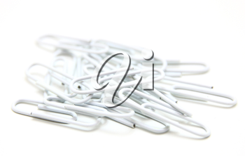Color paper clips to background. Isolated on white background