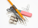 shot of eraser, pencil and pencil metal double sharpener on a white background