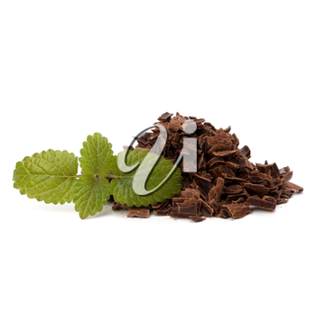 Crushed chocolate shavings pile and mint leaf isolated on white background