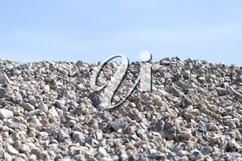 stones on nature on a background of blue sky