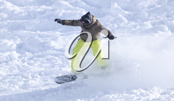 people snowboarding on the snow in the winter