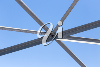 metal construction on a background of blue sky