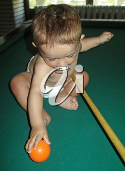 Little boy playing snooker