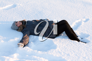 Royalty Free Photo of a Young Woman Lying in Snow
