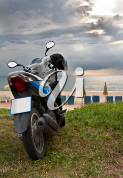 Royalty Free Photo of a Motorcycle by the Beach