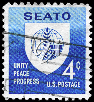 Royalty Free Photo of 1960 US Stamp Shows the SEATO Emblem, Inscribed Unity Peace Progres