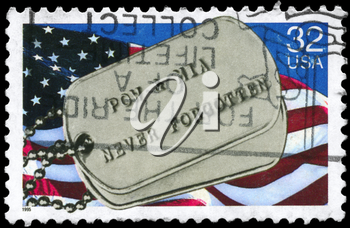 Royalty Free Photo of 1995 US Stamp Shows the US Flag and Military Badge, With the Words Prisoners of War and Missing in Action Never Forgotten