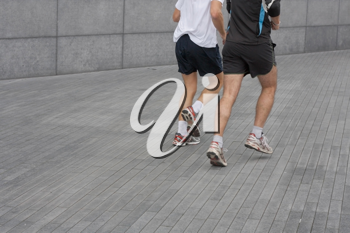 Royalty Free Photo of Two People Running