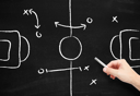 Royalty Free Photo of Sports Tactics on a Chalkboard