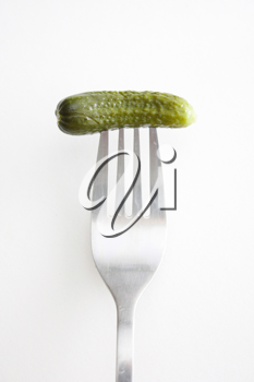 Royalty Free Photo of a Pickle on a Fork