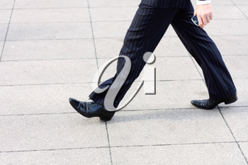 Royalty Free Photo of a Businessman Walking