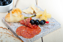 cold cut assortment cheese salami and fresh pears
