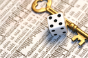 Royalty Free Photo of a Dice and Key on a Newspaper