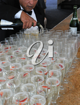 Royalty Free Photo of a Man Pouring Champagne