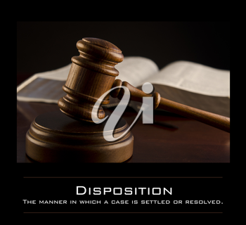 Royalty Free Photo of a Gavel and Book With the Definition of Disposition