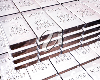 Royalty Free Clipart Image of Stacks of Pure Silver Bars on Piles of Bullion
