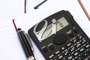 Royalty Free Photo of a Calculator on a Notebook