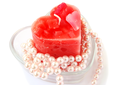 Royalty Free Photo of a Candle and Pearls