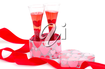 Red ribbon, two glasses and gift box isolated on white background.